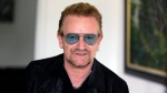 In this Friday, Aug. 28, 2015, file photo, Irish rock star Bono speaks during an interview with The Associated Press in Lagos, Nigeria. (AP Photo/Sunday Alamba)