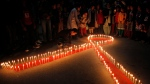 "Nepalese women and children from ""Maiti Nepal"", a rehabilitation center for victims of sex trafficking, light candles on the eve of World AIDS Day in Kathmandu, Nepal, Monday, Nov. 30, 2015. (AP Photo/Niranjan Shrestha)"