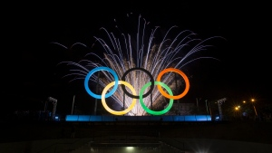 Fireworks explode behind the Olympics rings during thier inauguration at the Madureira Park in Rio de Janeiro, Brazil, Wednesday, May 20, 2015. The rings are a gift from the city of London. (AP / Felipe Dana)
