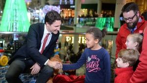 Prime Minister Justin Trudeau is seen greeting children while visiting CTV's Toy Mountain drive at the Toronto Eaton Centre on Dec. 14, 2015.