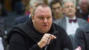 Internet entrepreneur Kim Dotcom speaks during the Intelligence and Security select committee hearing at Parliament in Wellington, New Zealand on Wednesday, July 3, 2013 file photo. (Mark Mitchell / New Zealand Herald)