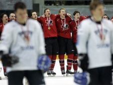 Canada's team players sing the national anthem after beating Finland at the World Ice Hockey championship final match in Moscow, Sunday, May 13, 2007. Canada won 4-2. (AP / Dmitry Lovetsky)