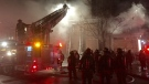 Toronto firefighters work to put out a blaze on Jarvis Street early Monday, Jan. 4, 2016. (Mike Nguyen)