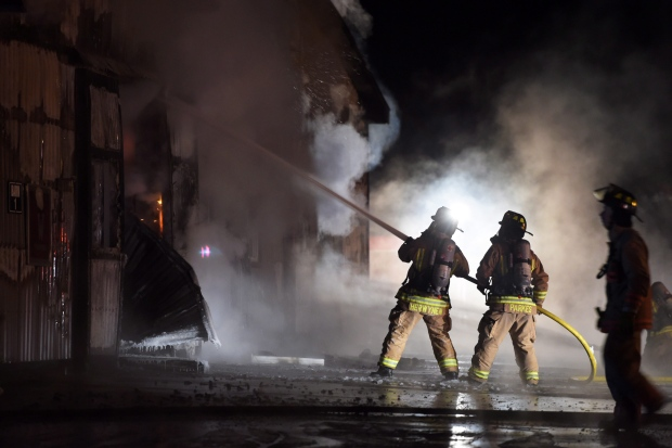 A fire tore through a barn in Puslinch, Ont., killing more than 40 racehorses. <br><br>Firefighters work to bring a blaze under control at the Classy Lane Stables, in Puslinch, Ont., on Jan. 5, 2015. (Andrew Collins  / THE CANADIAN PRESS)