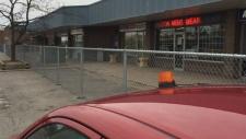 Fence divides Bolton parking lot