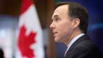 Finance Minister Bill Morneau speaks at the Munk School of Global Affairs in Toronto on Wednesday, January 13, 2016. THE CANADIAN PRESS/Peter Power