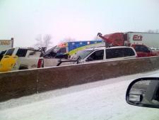 Emergency vehicles respond to a vehicle crash along Hwy. 400, north of Toronto, Friday, Dec. 19, 2008. (Veronica Nuspl / MyNews.CTV.ca)