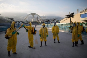 In this Jan. 26, 2016 file photo, health workers get ready to spray insecticide to combat Zika under the bleachers of a 2016 Summer Olympics venue, the Sambadrome in Rio de Janeiro. (Leo Correa / AP)