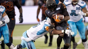 Toronto Argonauts safety Jermaine Gabriel (5) tackles B.C. Lions running back Stefan Logan (10) during fourth quarter CFL action in Toronto on Sunday August 17, 2014. (Frank Gunn / THE CANADIAN PRESS)