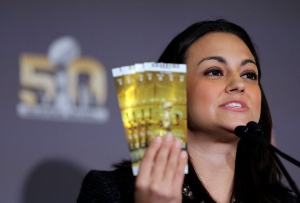 Dolores F. Dibella, NFL Counsel, holds up authentic Super Bowl 50 tickets during a counterfeit merchandise news conference Thursday, Feb. 4, 2016, in San Francisco. (AP/David J. Phillip)