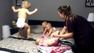 Quadruple trouble: Mom changes triplets, toddler a