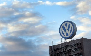 In this Sept. 26, 2015 file photo a giant logo of the German car manufacturer Volkswagen is pictured on top of a company's factory building in Wolfsburg, Germany. (AP/Michael Sohn)
