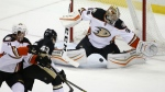 Pittsburgh Penguins' Conor Sheary deflects the puck between the legs of Anaheim Ducks goalie John Gibson during the first period of an NHL hockey game against the Anaheim Ducks in Pittsburgh on Monday, Feb. 8, 2016. (AP / Gene J. Puskar)