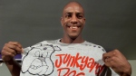 Toronto Raptors forward Jerome Williams shows off a t-shirt with his nickname 'Junkyard Dog' written on it at a news conference in Toronto on July 18, 2001. (Kevin Frayer / THE CANADIAN PRESS)