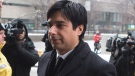 Former CBC radio host Jian Ghomeshi walks past protesters as he arrives at a Toronto court for day six of his trial on Tuesday, Feb. 9, 2016. T(HE CANADIAN PRESS/Chris Young)