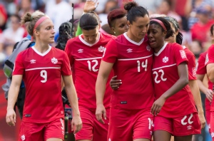 Canada's Josee Belanger, from left to right, Christine Sinclair, Melissa Tancredi and Ashley Lawrence react after losing 2-1 to England during a FIFA Women's World Cup quarter-final soccer game in Vancouver, B.C., on June 27, 2015. (Darryl Dyck / The Canadian Press)