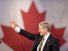 Prime Minister Stephen Harper waves to supporters following his keynote address at the Conservative Convention in Winnipeg, on Thursday, Nov.13, 2008. (Adrian Wyld / THE CANADIAN PRESS)