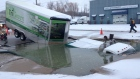 Truck stuck in giant sinkhole in Kitche