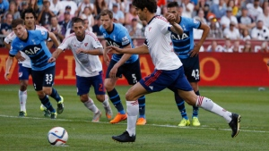 MLS All-Star midfielder Kaka, front, makes a penalty kick against Tottenham Hotspurs during the first half of the MLS All-Star soccer game Wednesday, July 29, 2015, in Commerce City, Colo. The MLS All-Star squad won 2-1 in the 20th annual mid-season classic for the league. (AP Photo/David Zalubowski)