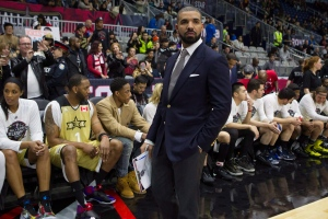 Drake stands in front of Team Canada's bench before the start of the NBA celebrity all-star game in Toronto on Friday February 12, 2016. (Chris Young/THE CANADIAN PRESS)