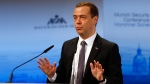 Russian Prime Minister Dmitry Medvedev gestures during his speech on the podium at the Security Conference in Munich, Germany, Saturday, Feb. 13, 2016. (AP / Matthias Schrader)