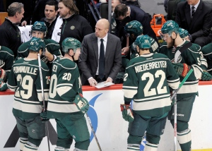 Minnesota Wild head coach Mike Yeo, center, diagrams a play for his players on Tuesday, Feb. 9, 2016, in St. Paul, Minn. (AP / Tom Olmscheid)