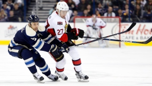 Ottawa Senators' Curtis Lazar, right, carries the puck up the ice as Columbus Blue Jackets' Gregory Campbell defends during the first period of an NHL hockey game Saturday, Feb. 13, 2016, in Columbus, Ohio. (AP Photo / Jay LaPrete)