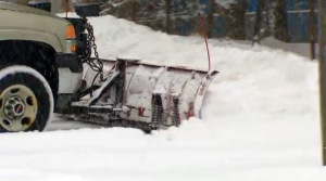 A plow pushes the snow in Toronto on Tuesday, Feb. 16, 2016.