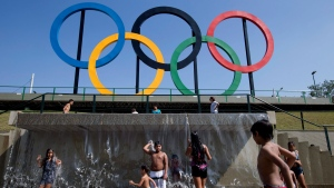 In this July 28, 2015 file photo, children play in a water fountain next to Olympic rings at Madureira Park in Rio de Janeiro, Brazil. (AP Photo/Silvia Izquierdo)