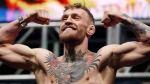 Conor McGregor poses on the scale during the weigh-in for UFC 194 in Las Vegas on Friday, Dec. 11, 2015. (AP / John Locher)