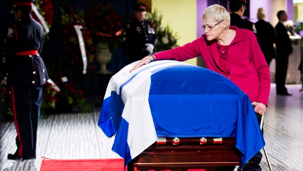 A woman pays her respects to former Toronto mayor Rob Ford's casket at city hall on Monday, March 28, 2016. Ford died of cancer last week, at the age of 46. THE CANADIAN PRESS/Nathan Denette