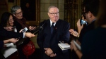 Senator Jacques Demers speaks to media in the foyer of the Senate on Parliament Hill in Ottawa on Dec. 3, 2015. THE CANADIAN PRESS/Sean Kilpatrick