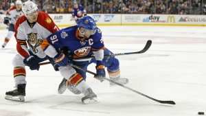 Florida Panthers defenceman Dmitry Kulikov keeps New York Islanders centre John Tavares from the puck in the first overtime period of Game 6 of an NHL hockey first-round Stanley Cup playoff series in New York, Sunday, April 24, 2016. (AP / Kathy Willens)