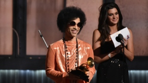 Prince presents the award for album of the year at the 57th annual Grammy Awards in Los Angeles on Feb. 8, 2015. (John Shearer / Invision)