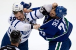 Toronto Maple Leafs' Colton Orr, left, and Vancouver Canucks' Tom Sestito fight during second period NHL hockey action in Vancouver, B.C., on November 2, 2013. (Darryl Dyck / The Canadian Press)