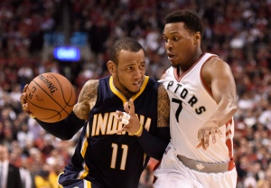 Indiana Pacers' Monta Ellis (11) drives towards the net as Toronto Raptors' Kyle Lowry (7) defends with only seconds left in the second half of NBA playoff basketball action in Toronto on Tuesday, April 26, 2016. Ellis do not score on the play. THE CANADIAN PRESS/Frank Gunn