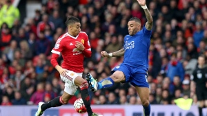 Manchester United's Jesse Lingard, left, and Leicester City's Danny Simpson in action during their English Premier League soccer match at Old Trafford, Manchester, England, Sunday May 1, 2016. (Martin Rickett / PA via AP)