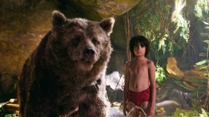 "In this image released by Disney, Mowgli, portrayed by Neel Sethi, right, and Baloo the bear, voiced by Bill Murray, appear in a scene from, ""The Jungle Book."" (Disney via AP)"