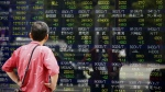 A man looks at an electronic stock indicator of a securities firm in Tokyo, Monday, May 2, 2016. (AP / Shizuo Kambayashi)