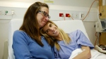 Carolyn Lloyd, left, of Charlotte, N.C., comforts her daughter Rachel at Wellington Hospital in Wellington, New Zealand on Monday, May 2, 2016. (AP / Nick Perry)