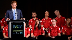 Prince Harry delivers a speech to assembled guests as Canadian Invictus athletes look on during a ceremony to promote the 2017 Invictus Games on May 2, 2016. (Nathan Denette / THE CANADIAN PRESS)