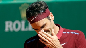 Swiss Roger Federer gestures during his quarter final match of the Monte Carlo Tennis Masters tournament against France's Jo-Wilfried Tsonga, in Monaco on April 15, 2016. (AP Photo/Lionel Cironneau, File)