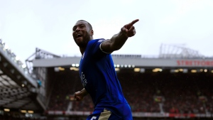 Leicester's Wes Morgan celebrates after scoring during the English Premier League soccer match between Manchester United and Leicester at Old Trafford Stadium, Manchester, England, Sunday, May 1, 2016. (AP Photo / Jon Super)