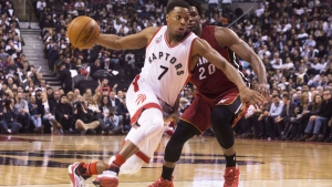 Toronto Raptors' Kyle Lowry (7) drives past Miami Heat's Justise Winslow (20) during first half NBA basketball action in Toronto on Friday January 22, 2016 (Chris Young / THE CANADIAN PRESS)