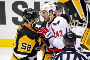 Washington Capitals' Tom Wilson (43) grabs Pittsburgh Penguins' Kris Letang (58) by the sweater during the first period of Game 3 in an NHL hockey Stanley Cup Eastern Conference semifinals in Pittsburgh, Monday, May 2, 2016. (AP / Gene J. Puskar)