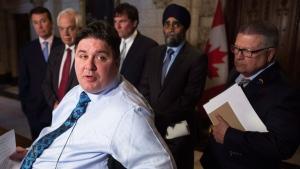 Minister of Veterans Affairs and Associate Minister of National Defence Kent Hehr responds to a question on the Auditor General's report with Treasury Board President Scott Brison, left to right, Immigration Minister John McCallum, Government House leader Dominic Leblanc, Defence Minister Harjit Sajjan and Public Safety Minister Ralph Goodale looking on during a news conference on Parliament Hill in Ottawa on Tuesday, May 3, 2016. (Adrian Wyld / THE CANADIAN PRESS)