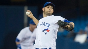 Toronto Blue Jays starting pitcher Marco Estrada works against Texas Rangers during first inning AL baseball action in Toronto on Tuesday May 3 , 2016. THE CANADIAN PRESS/Chris Young