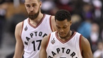 Toronto Raptors' Kyle Lowry and Jonas Valanciunas walks towards the bench late in regulation time game one second round NBA playoff basketball action against the Miami Heat in Toronto on Tuesday, May 3, 2016. (Frank Gunn / THE CANADIAN PRESS)