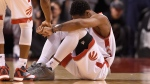 Toronto Raptors' DeMar DeRozan sits on the floor as teammate Kyle Lowry offers a hand during game one second round NBA playoff basketball action in Toronto on Tuesday, May 3, 2016. (Frank Gunn / THE CANADIAN PRESS)