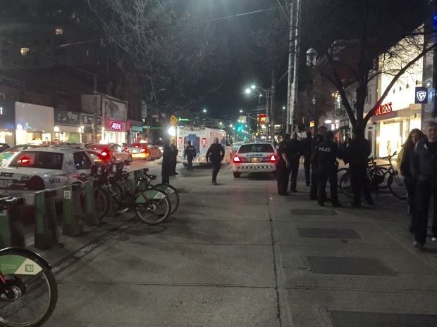 Police say a man who was reportedly carrying a hatchet and damaging property in the Entertainment District has been taken into custody. (Mike Nguyen/ CP24)
